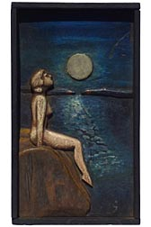 Carving of woman in moonlight