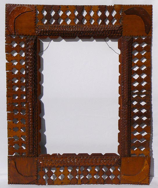 'Tramp art frame with moons' from the web at 'http://www.folkartisans.com/pages/../images10/twhr_big.jpg'