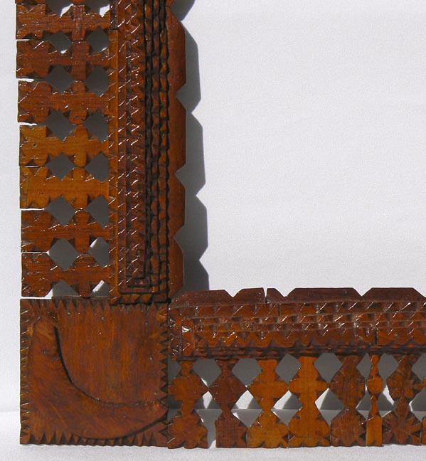 'Closeup, lower left' from the web at 'http://www.folkartisans.com/pages/../images10/twhr_cl1_big.jpg'