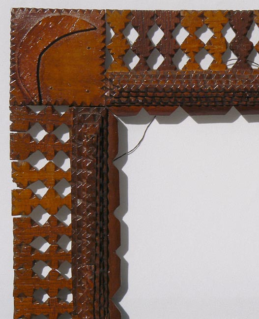 'Closeup, upper left' from the web at 'http://www.folkartisans.com/pages/../images10/twhr_cl4_big.jpg'
