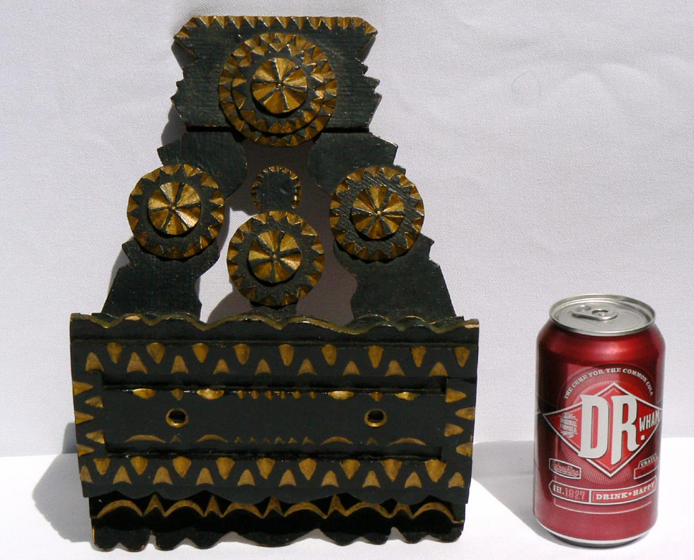 'With a soda can for scale' from the web at 'http://www.folkartisans.com/pages/../images11/cssw_scale.jpg'