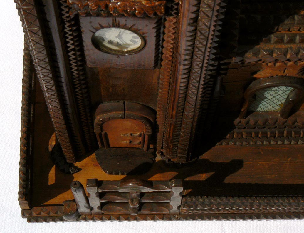 'Clock, doorway, from above' from the web at 'http://www.folkartisans.com/pages/../images11/trwp_above_cl1.jpg'
