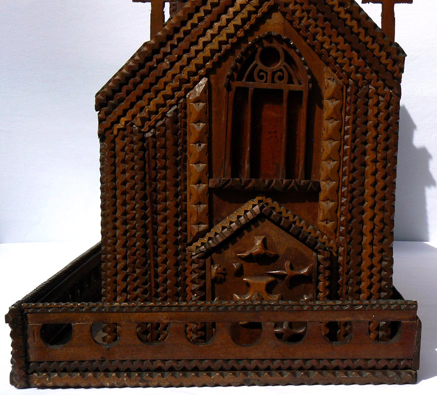 'Lower closeup of end' from the web at 'http://www.folkartisans.com/pages/../images11/trwp_cl2.jpg'