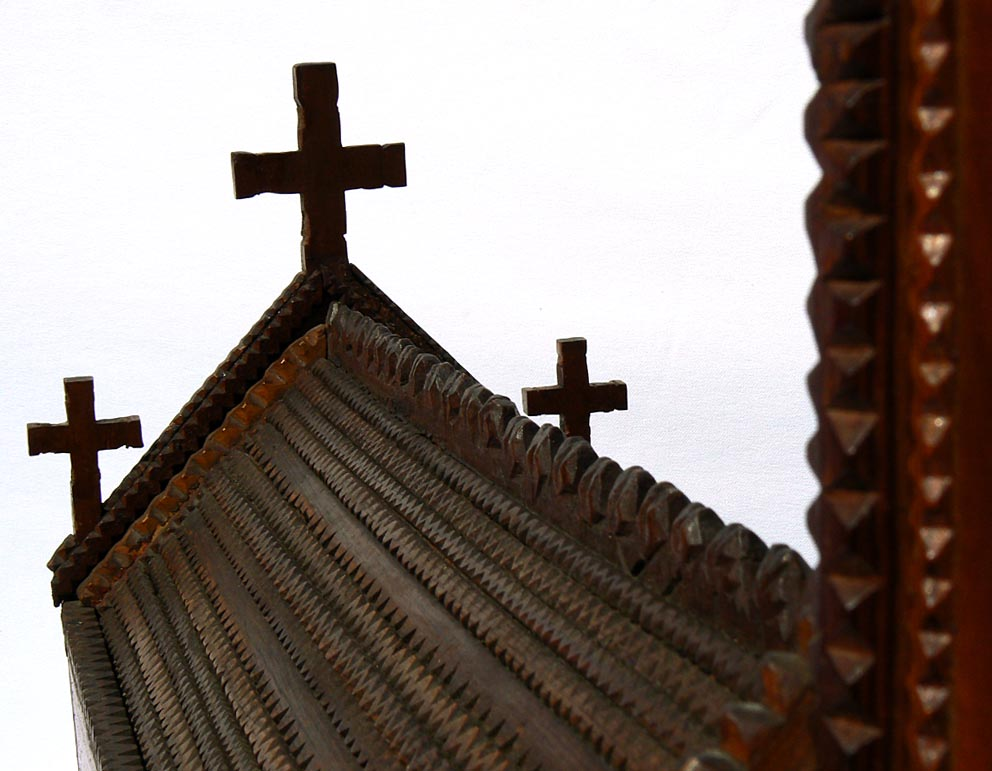 'Roof, crosses' from the web at 'http://www.folkartisans.com/pages/../images11/trwp_cl9.jpg'