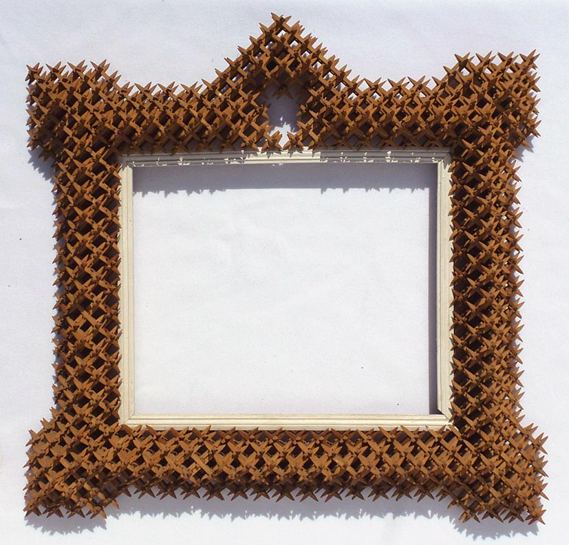 'Crown of thorns tramp art frame' from the web at 'http://www.folkartisans.com/pages/../images12/cawk.jpg'