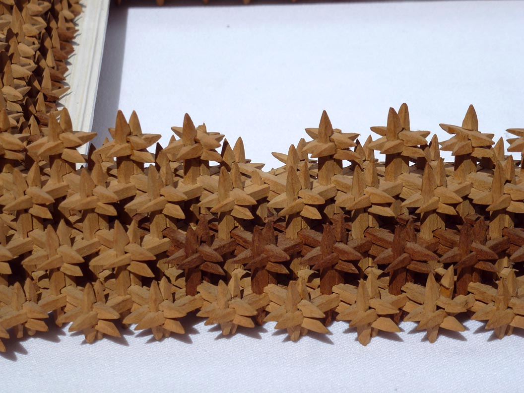 'Closeup of lower edge' from the web at 'http://www.folkartisans.com/pages/../images12/cawk_cl_below.jpg'