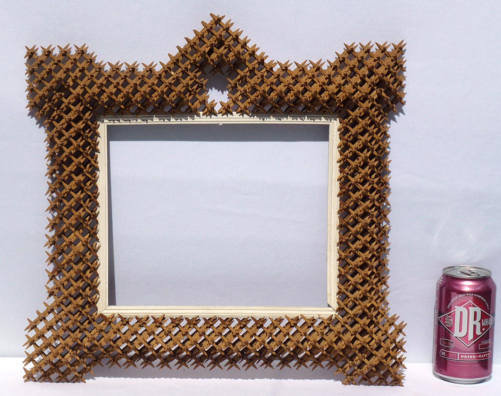 'With a soda can for scale' from the web at 'http://www.folkartisans.com/pages/../images12/cawk_scale.jpg'