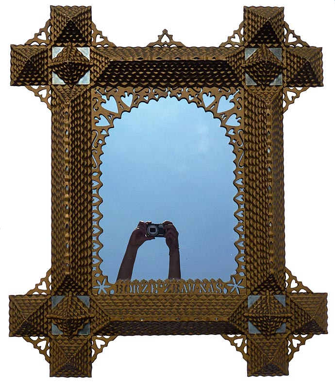 'Large, intricate tramp art frame' from the web at 'http://www.folkartisans.com/pages/../images12/cphs.jpg'