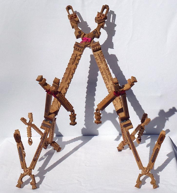'Intricate folding whimsy' from the web at 'http://www.folkartisans.com/pages/../images12/ctkh.jpg'