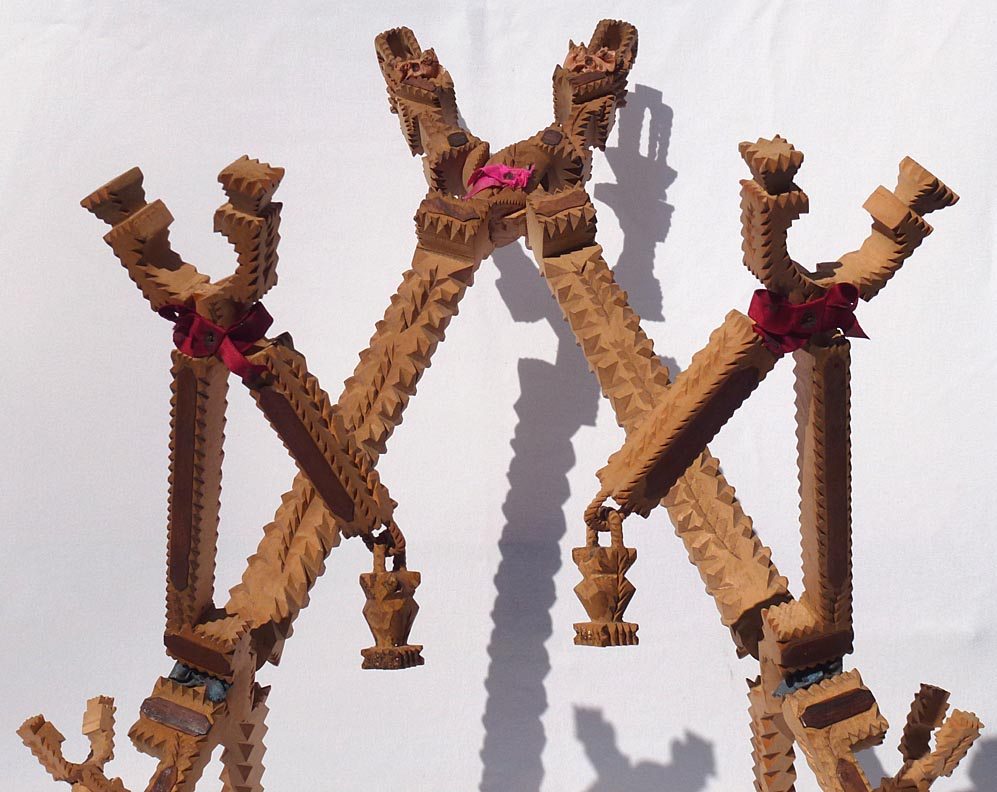 'Closeup center section' from the web at 'http://www.folkartisans.com/pages/../images12/ctkh_cl_middle1.jpg'