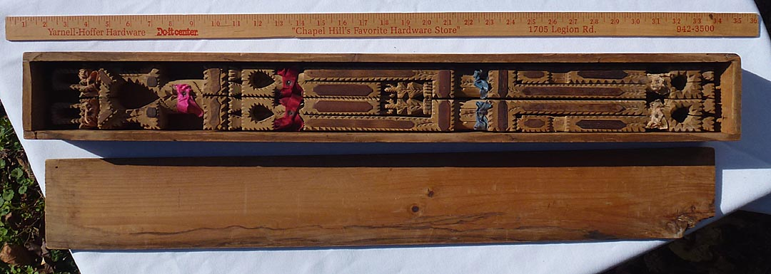 'In box, with a yardstick for scale' from the web at 'http://www.folkartisans.com/pages/../images12/ctkh_scale2.jpg'