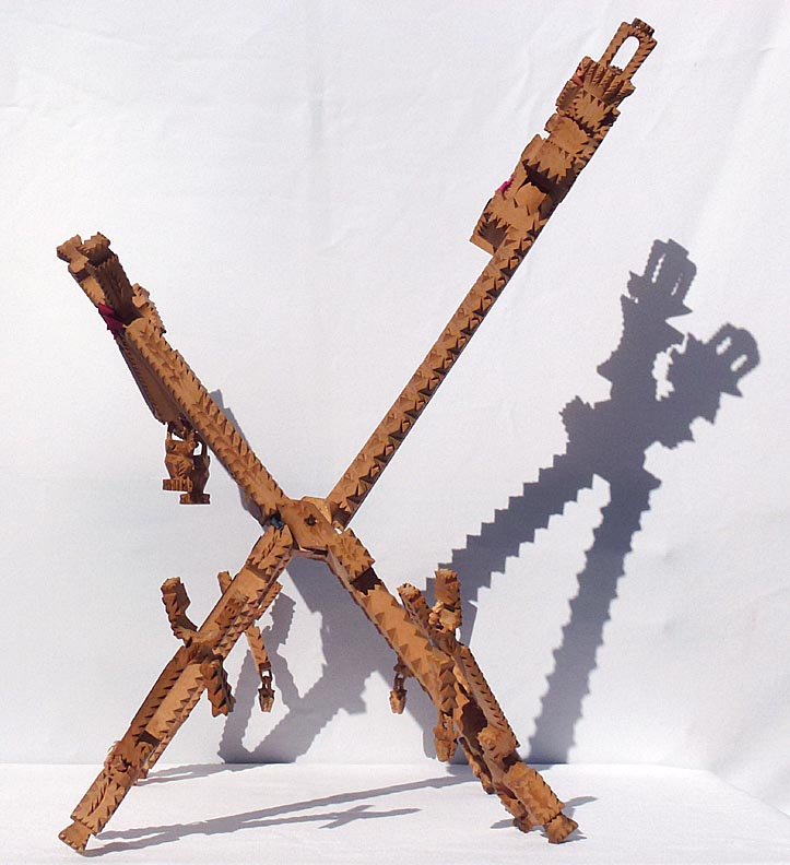 'Another side angle' from the web at 'http://www.folkartisans.com/pages/../images12/ctkh_side1a.jpg'