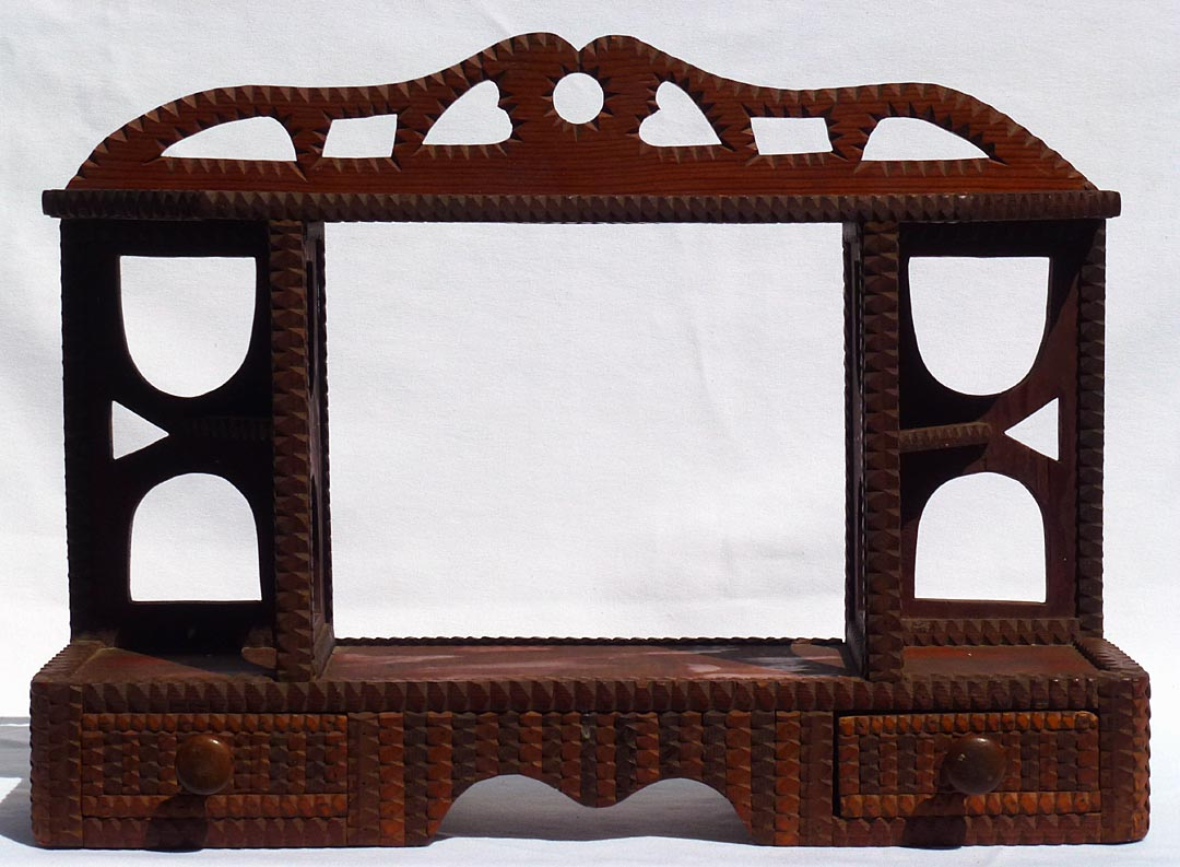 'Tramp art shelf with drawers' from the web at 'http://www.folkartisans.com/pages/../images12/ctop.jpg'