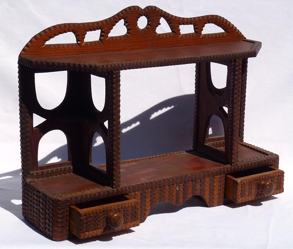 'With drawers open' from the web at 'http://www.folkartisans.com/pages/../images12/ctop_open.jpg'
