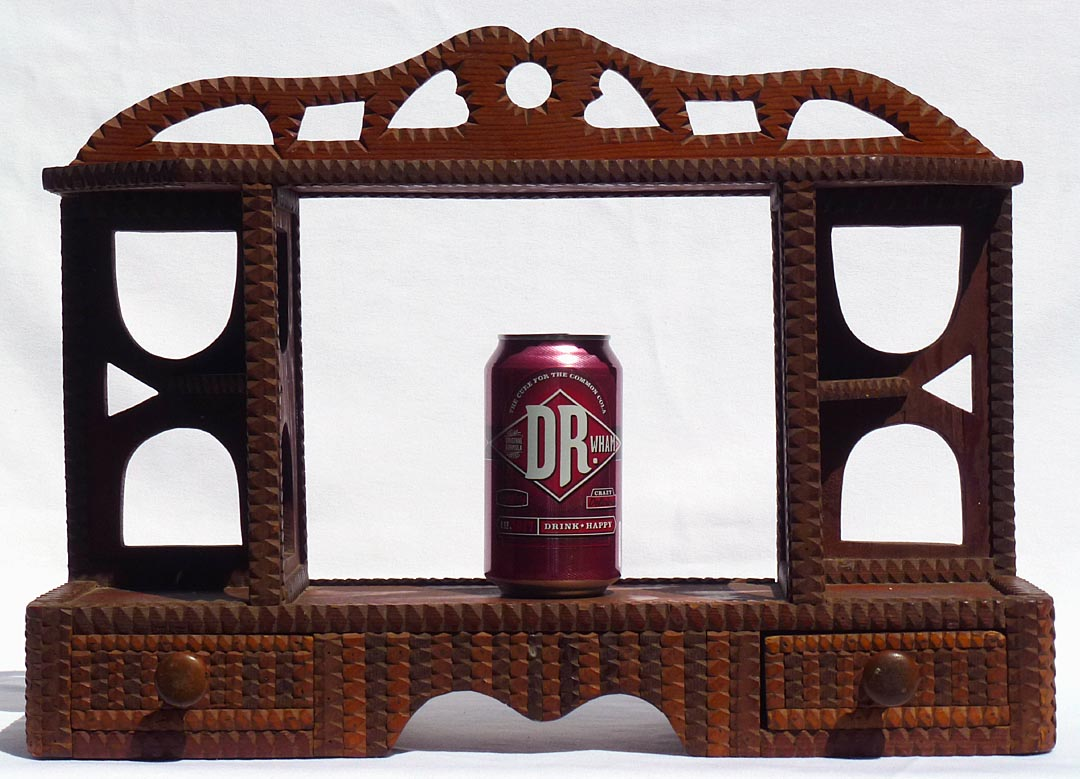 'With a soda can for scale' from the web at 'http://www.folkartisans.com/pages/../images12/ctop_scale.jpg'