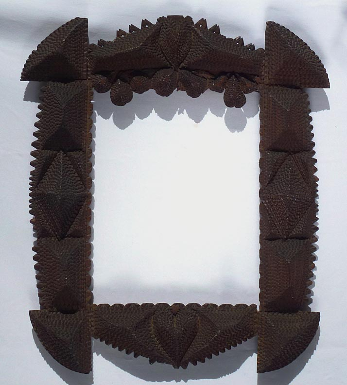 'Large tramp art frame with hearts, carved fruit' from the web at 'http://www.folkartisans.com/pages/../images12/ctss.jpg'