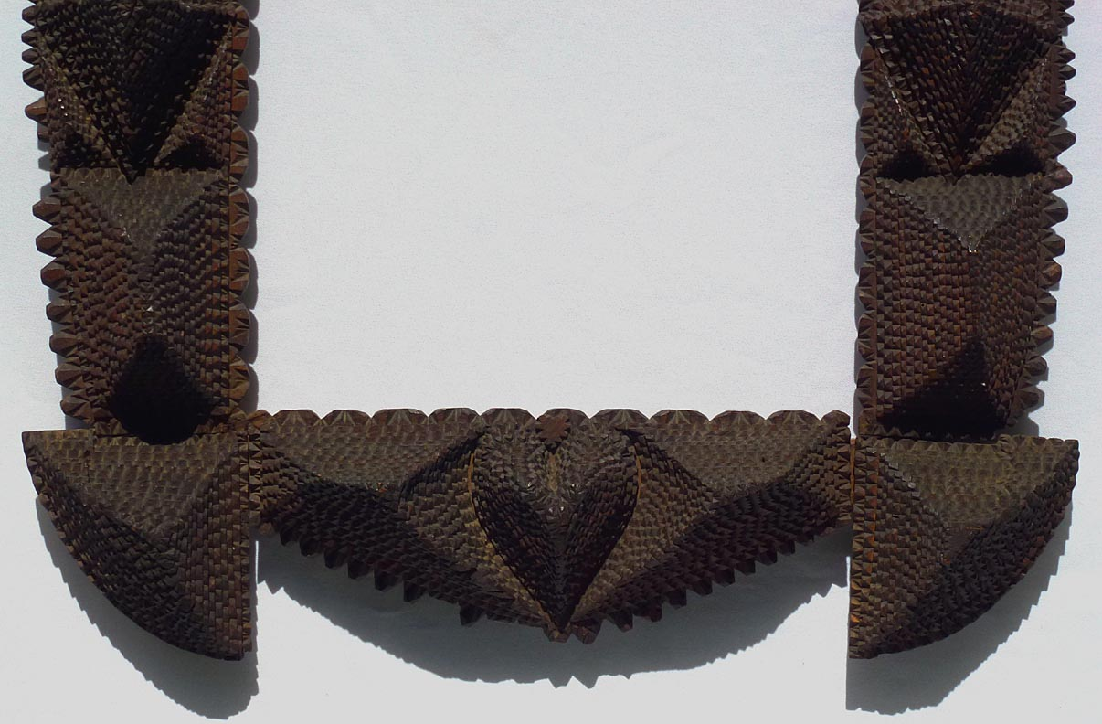 'Lower half' from the web at 'http://www.folkartisans.com/pages/../images12/ctss_cl3.jpg'