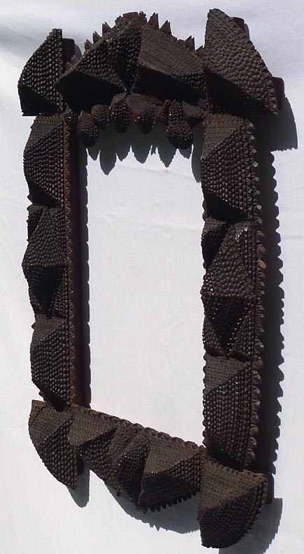 'Side view' from the web at 'http://www.folkartisans.com/pages/../images12/ctss_side1.jpg'