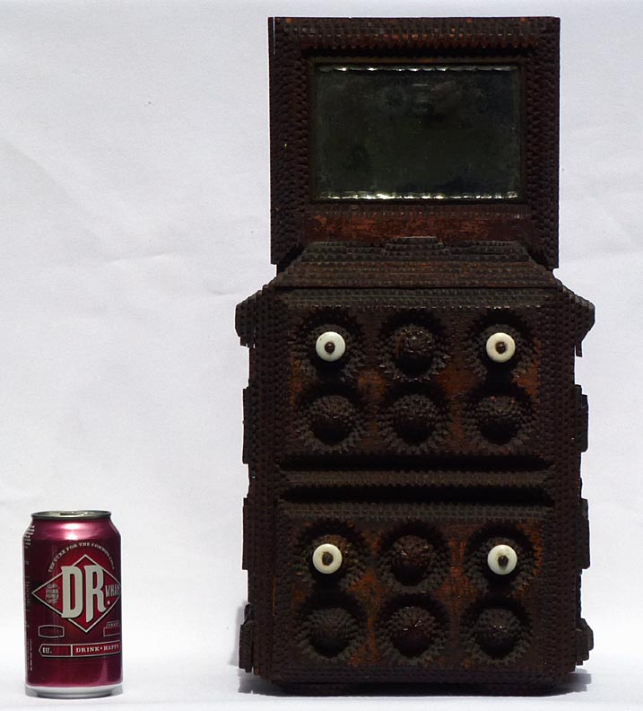'Front, with a soda can for scale' from the web at 'http://www.folkartisans.com/pages/../images12/ctwk_scale.jpg'