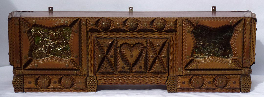 'Tramp art shelf with hidden compartments' from the web at 'http://www.folkartisans.com/pages/../images13/ccco.jpg'
