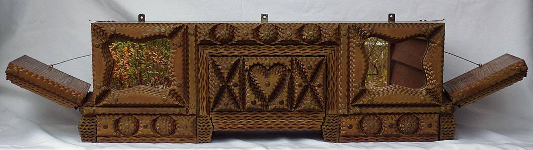 'Side doors open' from the web at 'http://www.folkartisans.com/pages/../images13/ccco_open2.jpg'