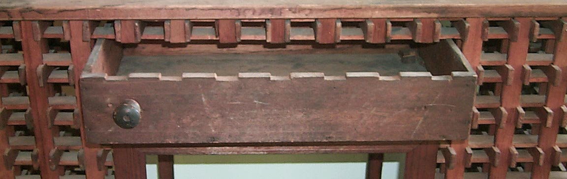 'Drawer open, showing notching' from the web at 'http://www.folkartisans.com/pages/../images2/pkok_drawer_big.jpg'