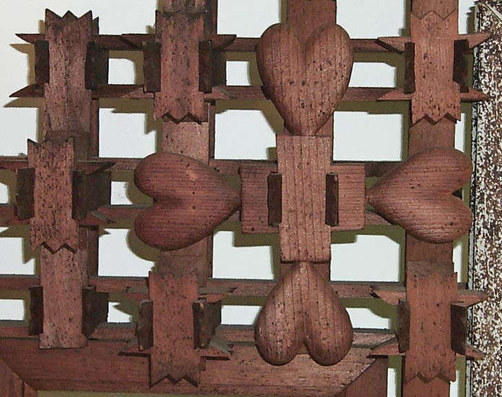 'Closeup of carved hearts' from the web at 'http://www.folkartisans.com/pages/../images2/pkok_hearts_big.jpg'