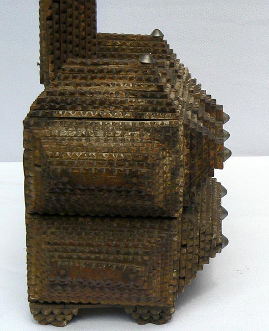 'Another side view of the base' from the web at 'http://www.folkartisans.com/pages/../images3/apak_cl_side3_big.jpg'