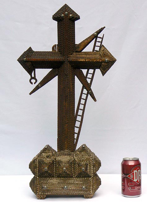 'With a soda can for scale' from the web at 'http://www.folkartisans.com/pages/../images3/apak_scale_big.jpg'