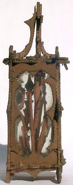 'The other side' from the web at 'http://www.folkartisans.com/pages/../images7/akao_side2_big.jpg'