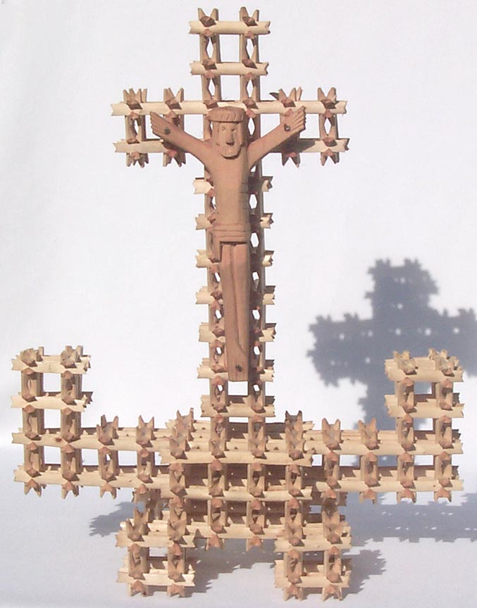 'Crown of thorns tramp art cross' from the web at 'http://www.folkartisans.com/pages/../images7/akat_big.jpg'