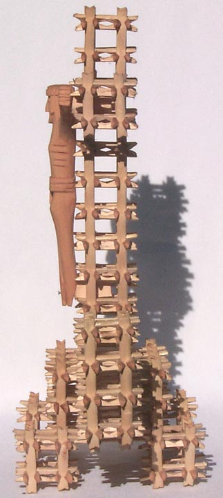 'One side' from the web at 'http://www.folkartisans.com/pages/../images7/akat_side1_big.jpg'
